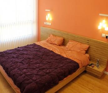 עיצוב דירת יוקרה, מיטת הורים בחדר השינה, עיצוב פנים ופנג שואי, ענבל קרקו.