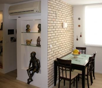 עיצוב דירה של אומן, מבט אל פינת האוכל, עיצוב פנים ופנג שואי, ענבל קרקו