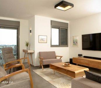 עיצוב בית מודרני לבני 60 +, מבט אל הסלון, ענבל קרקו, עיצוב פנים ופנג שואי
