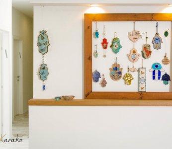 עיצוב פנים לבית בקיבוץ, מראה קיר החמסות, ענבל קרקו עיצוב פנים ופנג שואי